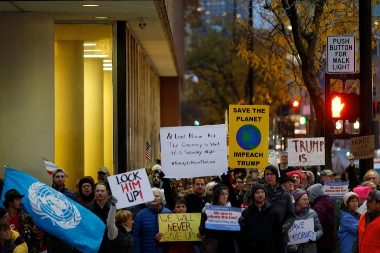 Demonstrators complete a loop of downtown during a nationwide protest following the resignation of attorney general Jeff Sessions and President Donald Trump's appointment of Matthew Whitaker at Piatt Park in downtown Cincinnati on Thursday, Nov. 8, 2018. (Photo: Sam Greene)